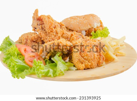 Fried chicken and burger with French Fries on wooden plate - stock photo