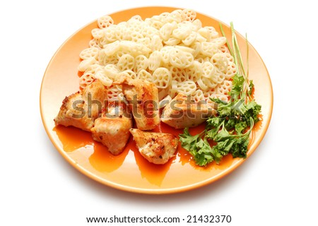 Fried chicken and round pasta on orange plate - stock photo