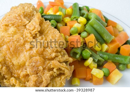 Fried chicken and vegetables - stock photo