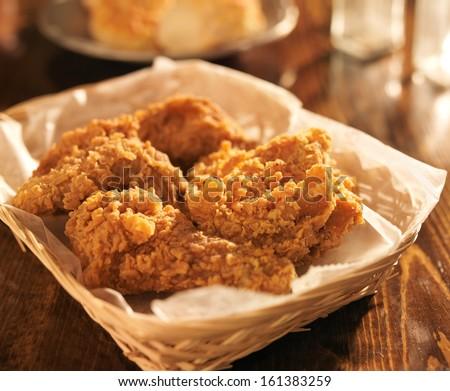 fried chicken basket in golden light - stock photo
