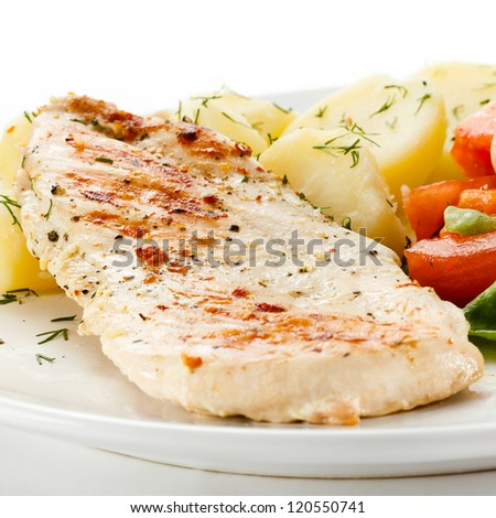 Fried chicken fillet, boiled potatoes and vegetables