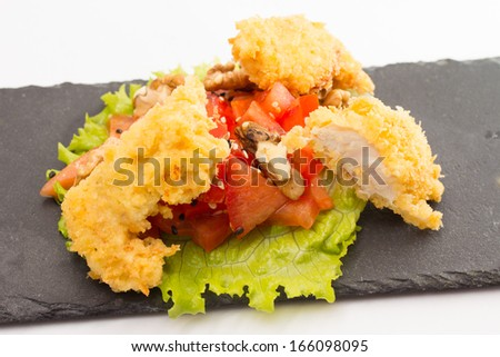 fried chicken fillet with vegetables isolated