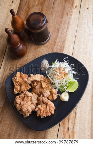 fried chicken in black plate - stock photo
