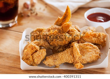 fried chicken in paper box - stock photo