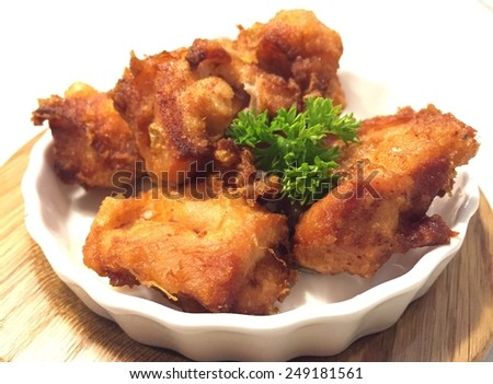 Fried chicken in white bowl - stock photo