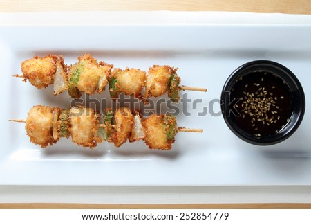 Fried Chicken Kushi sticks with onion and green pepper with dipping sauce. - stock photo