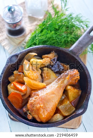 fried chicken leg with baked vegetables - stock photo