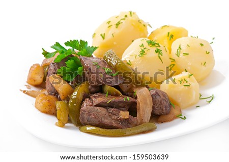 Fried chicken liver with apples, sweet pepper and onions - stock photo