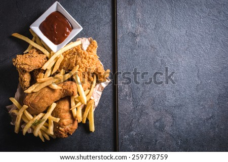 Fried chicken meat and French fries from above,blank space on the right side  - stock photo