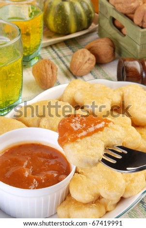 Fried chicken nuggets with sauce for dipping - stock photo