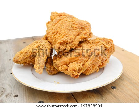 fried chicken on a plate on wooden board - stock photo