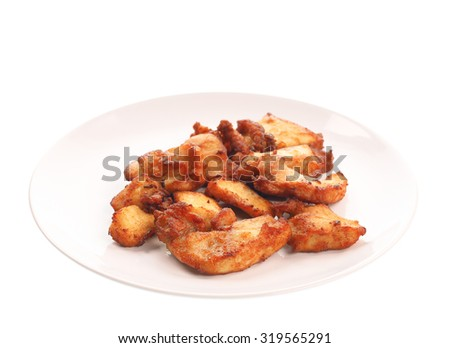 Fried chicken on plate isolated on white background.