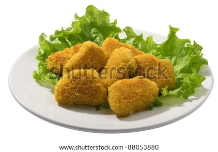 Fried chicken pieces coated with breadcrumbs with lettuce on the white plate - stock photo