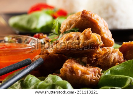 Fried chicken pieces in batter on a plate