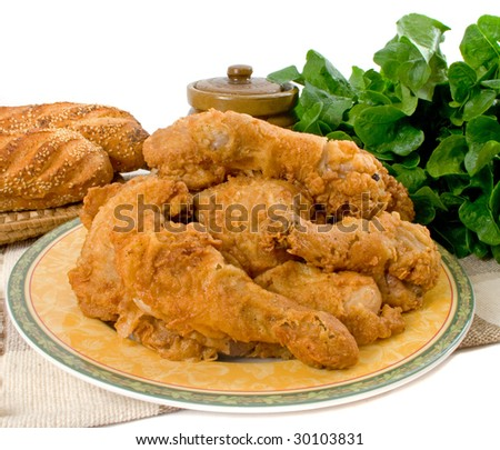 Fried chicken pieces over white background - stock photo