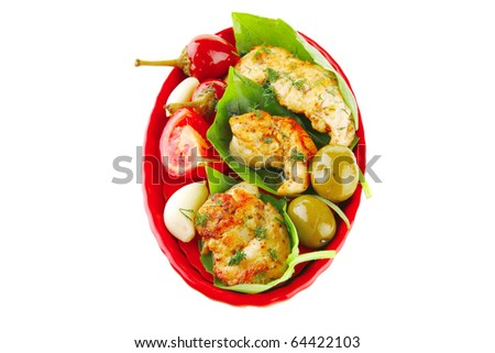 fried chicken pieces with vegetables on red