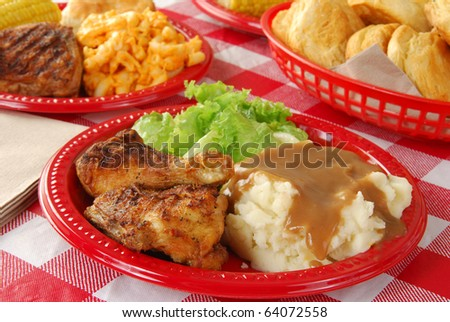 Fried chicken served on a picnic table - stock photo