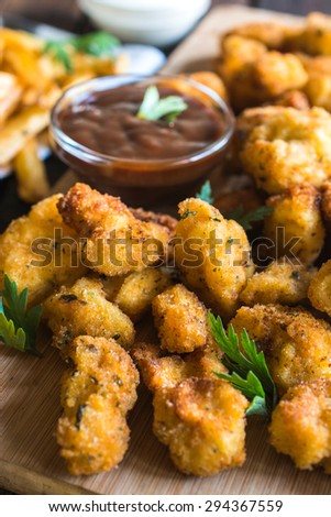 Fried chicken served on wooden board,selective focus  - stock photo