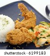 Fried chicken wings and rice - stock photo