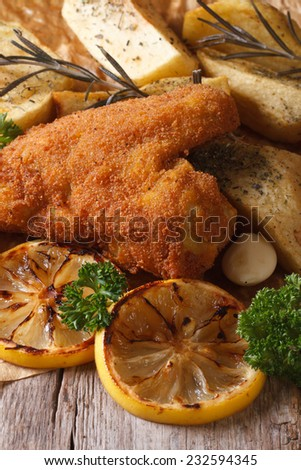 Fried chicken wings dipped in batter with vegetables close-up on the table. vertical  - stock photo