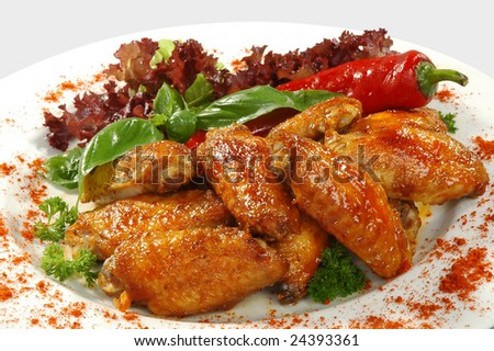 fried chicken wings in friture with red pepper - stock photo