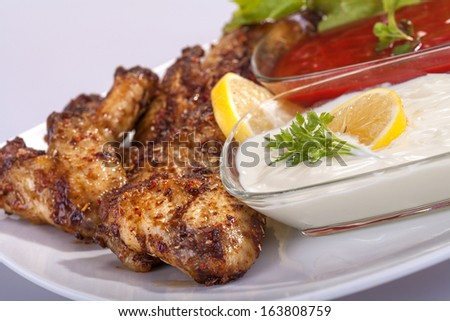fried chicken wings in sauce with mayonnaise and tomato sauce