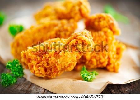 Fried Chicken Wings On Wooden Table Breaded Crispy Fried Kentucky Chicken Tasty Dinner