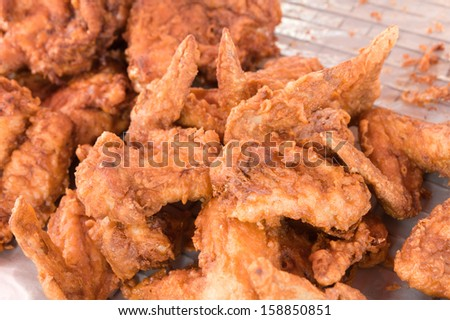 fried chicken wings sold in the fresh market, Thailand - stock photo