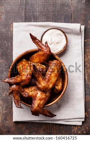 Fried Chicken Wings with sauce in wooden bowl - stock photo