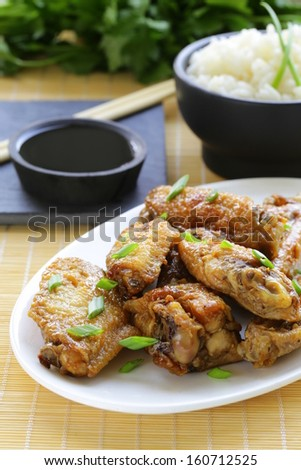 Fried chicken wings with spicy sauce in asian style  - stock photo