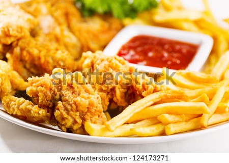 fried chicken with fries on a plate - stock photo