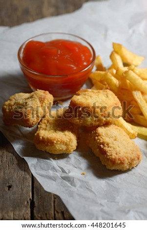 fried chicken with fries on a wooden table