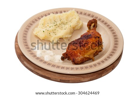 Fried chicken with mashed potatoes and tartar sauce. - stock photo