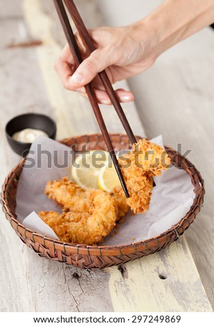 Fried Chicken with sauce in a basket on a wooden table, Chicken Selective focus