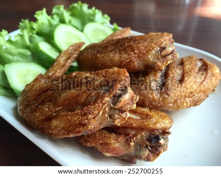 Fried chicken with vegetable on white plate