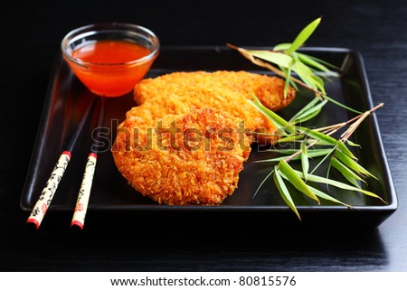 Fried chili chicken breast with hot dip - stock photo