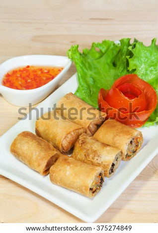 Fried Chinese Traditional Spring rolls food isolated on wood background