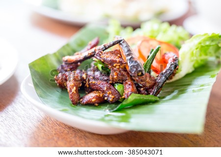 Fried chopped pork with herbs