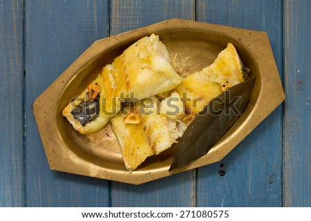 fried cod fish on dish - stock photo