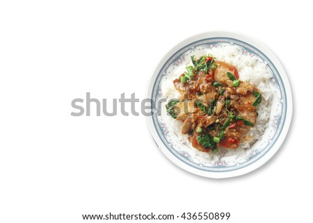 Fried crispy barbecue pork with basil leaves and chilly and egg over white steamed rice thai food on white background . - stock photo