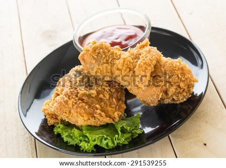 fried crispy chicken on wood - stock photo