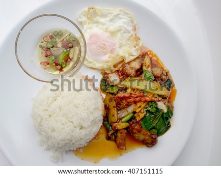 Fried crispy pork with Chili sauce and mix vegetable, with rice, fired egg. Thai Food.