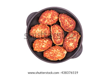 Fried cutlets in a cast iron skillet isolated on white background, top view - stock photo