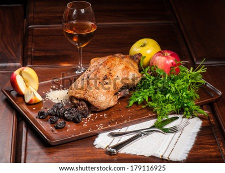 Fried duck stuffed with prunes and rice - stock photo