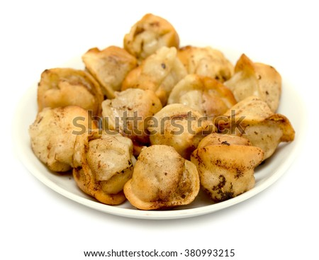 fried dumplings in a plate on a white background