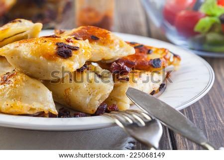 Fried dumplings stuffed with meat - stock photo