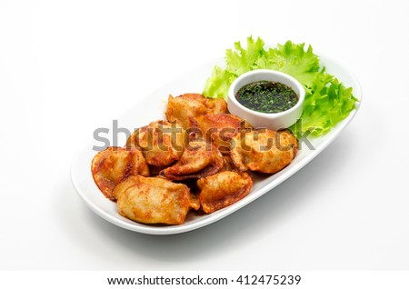 Fried dumplings with soy sauce - stock photo