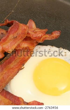 fried egg & bacon vertical - stock photo