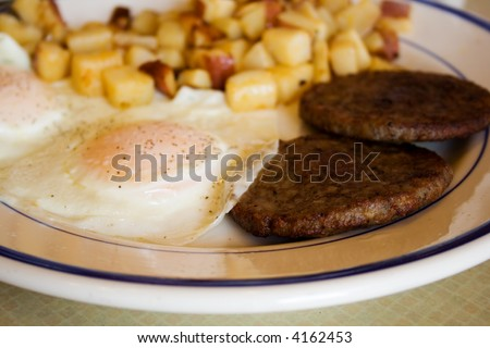 Fried Egg Breakfast with Sausage and Potatoes - stock photo