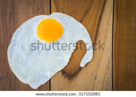 fried egg face halloween shape - stock photo